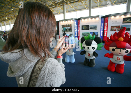 Hong Kong woman photographed the mascots of the Olympic Games 2008 in Beijing - Stock Photo