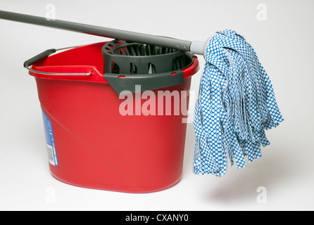Red mop bucket and mop - Stock Photo