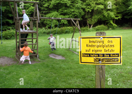 Roedinghausen, children on a playground with a sign - Stock Photo