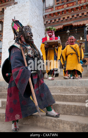 Masked dancers at Buddhist monastery, Ura, Bhutan, Asia - Stock Photo