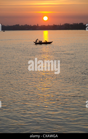 Traditional rowing boat on the river at sunset, Pathein, Irrawaddy Delta, Myamar (Burma), Asia - Stock Photo