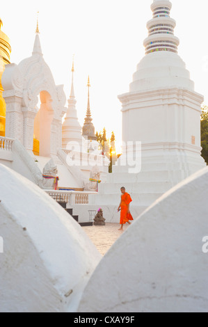 Buddhist monk walking around Wat Suan Dok Temple in Chiang Mai, Thailand, Southeast Asia, Asia - Stock Photo