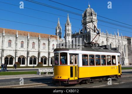 Mosteiro dos Jeronimos, UNESCO World Heritage Site, and tram (electricos), Belem, Lisbon, Portugal, Europe - Stock Photo