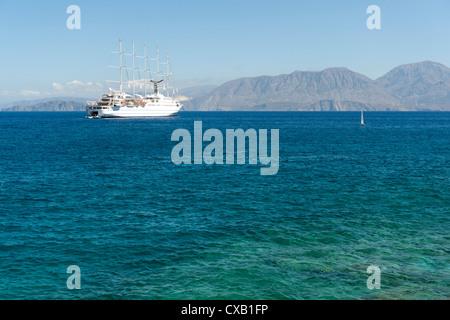 Club Med 2 at anchor off the resort of Agios Nikolaos Crete, Greece - Stock Photo