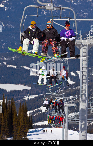 Chairlift carrying skiers and snowboarders, Whistler Mountain, Whistler Blackcomb Ski Resort, Whistler, British - Stock Photo