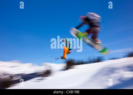 Snowboarder flying off a ramp, Whistler Mountain, Whistler Blackcomb Ski Resort, Whistler, British Columbia, Canada - Stock Photo
