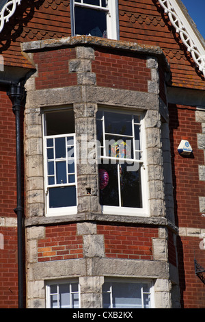 Helium Balloons For Age 16 Birthday In Windows Of House At Swanage September