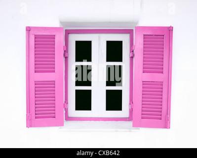 pink Greek Style windows on white wall - Stock Photo
