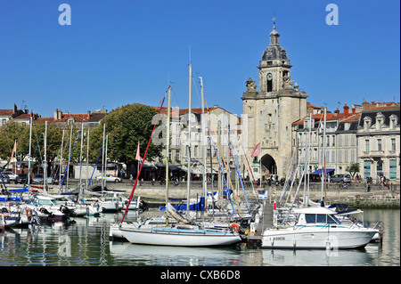 The town gate Grosse Horloge in the old harbour / Vieux-Port at La Rochelle, Charente-Maritime, Poitou-Charentes - Stock Photo