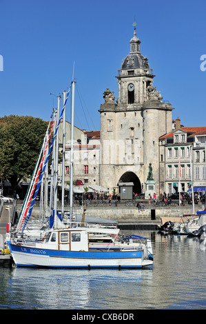 The town gate Grosse Horloge in the old harbour / Vieux-Port at La Rochelle, Charente-Maritime, France - Stock Photo