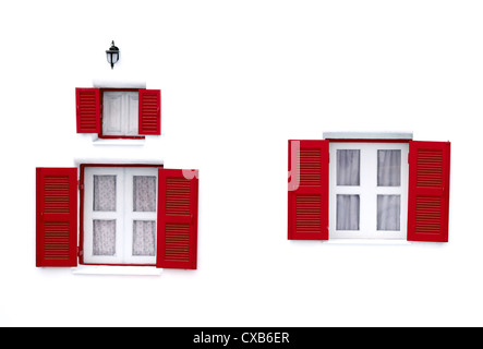 red Greek Style windows and lamp on white wall - Stock Photo