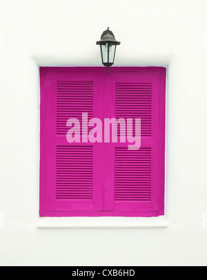 pink Greek Style windows and lamp on white wall - Stock Photo