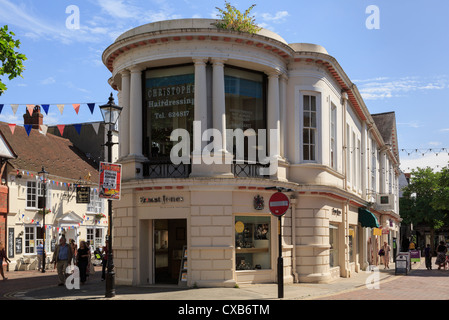 Street scene with Ernest Jones jewellers shop in the old town centre. Middle Row, High Street, Ashford, Kent, England, - Stock Photo