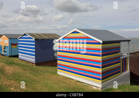 Colourful wooden beach huts overlooking the Thames estuary on the north Kent coast at Tankerton Whitstable Kent - Stock Photo