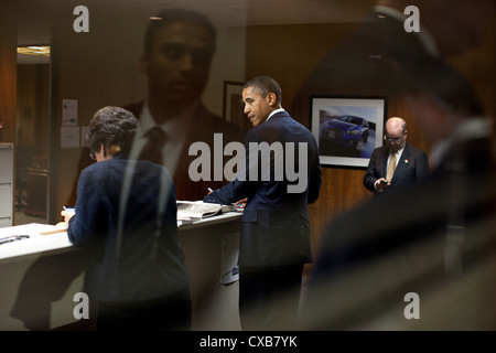 US President Barack Obama is seen through a window backstage at the General Motors Lake Orion Assembly Plant October - Stock Photo