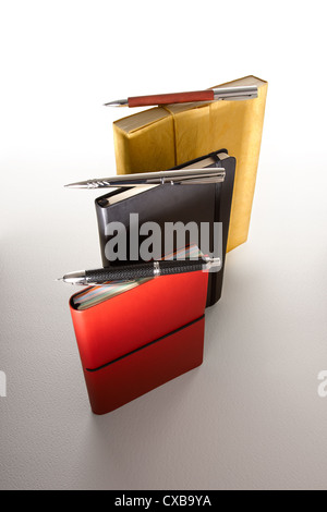 Notebooks and Pens - Stock Photo