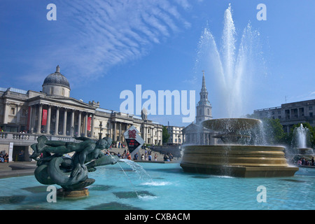 Tritons and dolphin fountain with the Olympic digital countdown clock and the National Gallery, Trafalgar Square, - Stock Photo