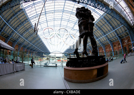 Statue the Meeting Place by Paul Day in the Eurostar terminal at St. Pancras Railway Station, London, Uited Kingdom - Stock Photo