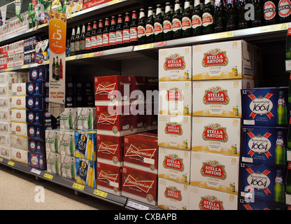 Cartons of beer in a tesco supermarket - Stock Photo