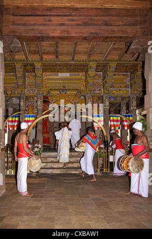 Drummers inside the Tooth Sanctuary, Temple of the Tooth Relic, UNESCO World Heritage Site, Kandy, Sri Lanka, Asia - Stock Photo