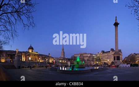 Trafalgar Square at dusk with Nelsons Column, St. Martin in the Fields and the National Gallery, London, England, - Stock Photo