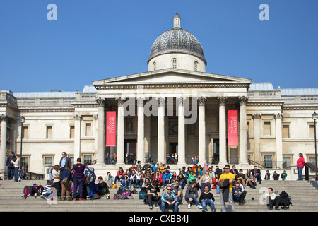 Visitors and tourists outside the National Gallery, Trafalgar Square, London, England, United Kingdom, Europe - Stock Photo