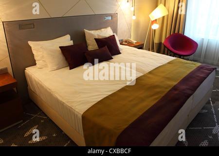 Bedroom in the Radisson Blu Hotel in Tallinn, Estonia. - Stock Photo