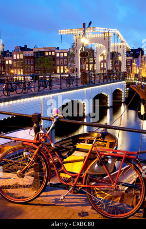 Magere Brug (Skinny Bridge) at dusk, Amsterdam, Holland, Europe - Stock Photo