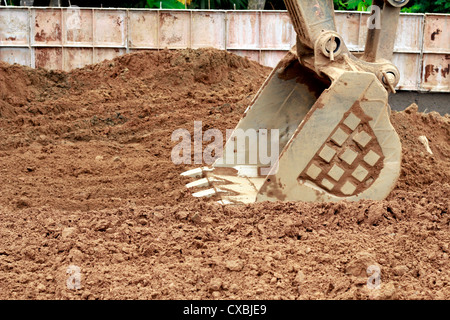 The Excavator Bucket of a digger at work - Stock Photo