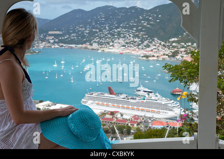 Woman looking at cruise ship in port, Charlotte Amalie, St. Thomas, U.S. Virgin Islands, West Indies, Caribbean, - Stock Photo