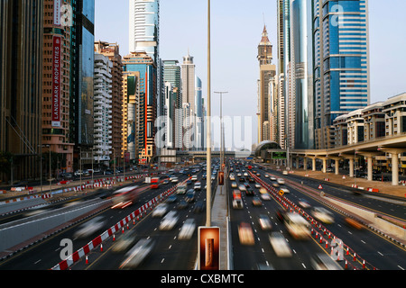 Traffic and new high rise buildings along Sheikh Zayed Road, Dubai, United Arab Emirates, Middle East - Stock Photo
