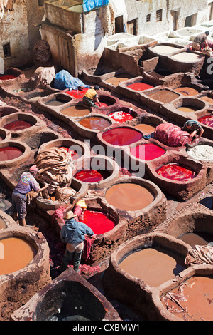 Vats for tanning and dyeing animal hides and skins, Chouwara traditional leather tannery in Old Fez, Fez, Morocco, - Stock Photo