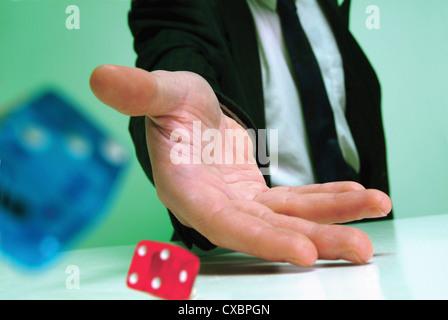businessman rolling dice - Stock Photo
