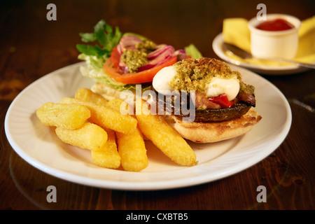 portobello mushroom burger with salad and chips - Stock Photo