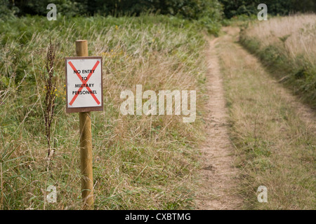 Sign 'No Entry for Military Personnel' country path - Stock Photo