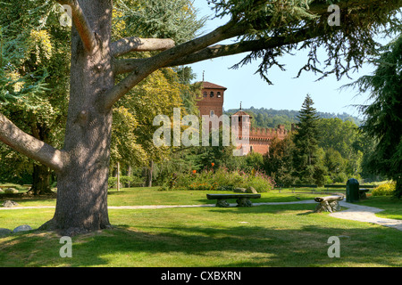 Medieval Castle among trees at botanical garden located at Valentino Park (Parco del Valentino) in Turin, Northern - Stock Photo