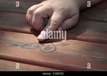 Drawing on the table in the park - Stock Photo