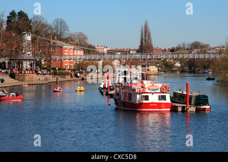 Boats and suspension bridge over the River Dee, Chester, Cheshire, England, United Kingdom, Europe - Stock Photo