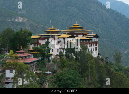 View of the Dzong in Trashigang with hills in the background, Eastern Bhutan, Bhutan, Asia - Stock Photo