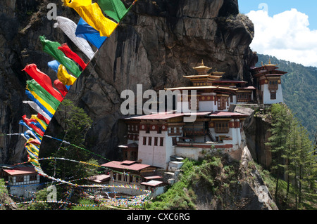 Taktshang Goemba (Tigers nest monastery) with prayer flags and cliff, Paro Valley, Bhutan, Asia - Stock Photo