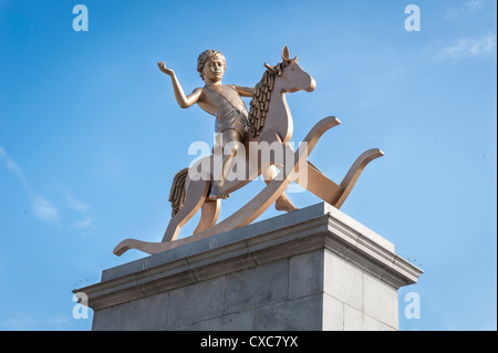 London Trafalgar Square Powerless Structures Fig 101 bronze statue Boy on a Rocking Horse 4th plinth by Elmgreen - Stock Photo