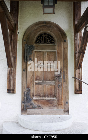 The door of the church at Château-d'Oex,a municipality in the canton of Vaud Switzerland. - Stock Photo