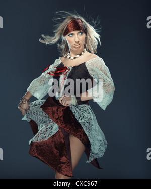 Female flamenco dancer on a studio background - Stock Photo