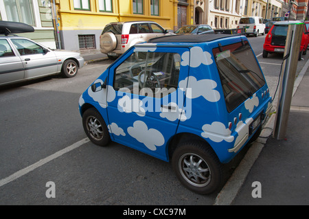 Electric car being charged on the street central Oslo Norway Europe - Stock Photo