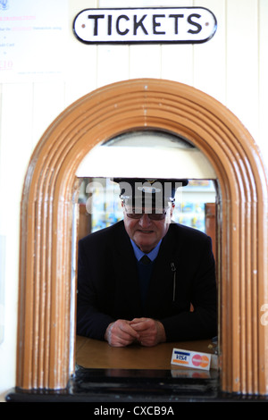 Ticket master at the railway station at Boat of Garten near Aviemore in the highlands of Scotland - Stock Photo
