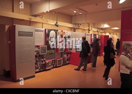 Visitors inside the Churchill War Rooms museum, Churchill's wartime bunker, London, UK. - Stock Photo