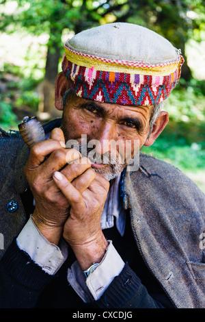 Portrait of Himachali man smoking chillum. Rumsu,Nagar, India - Stock Photo