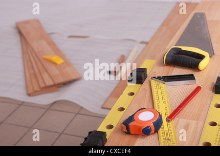 Tools on laminate flooring - Stock Photo