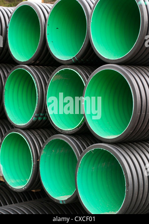 Pile of new PVC drainage / culvert pipes - Stock Photo