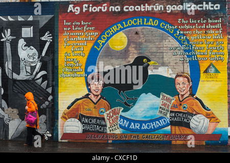 Political murals on Catholic Falls road, Belfast in Northern Ireland. - Stock Photo